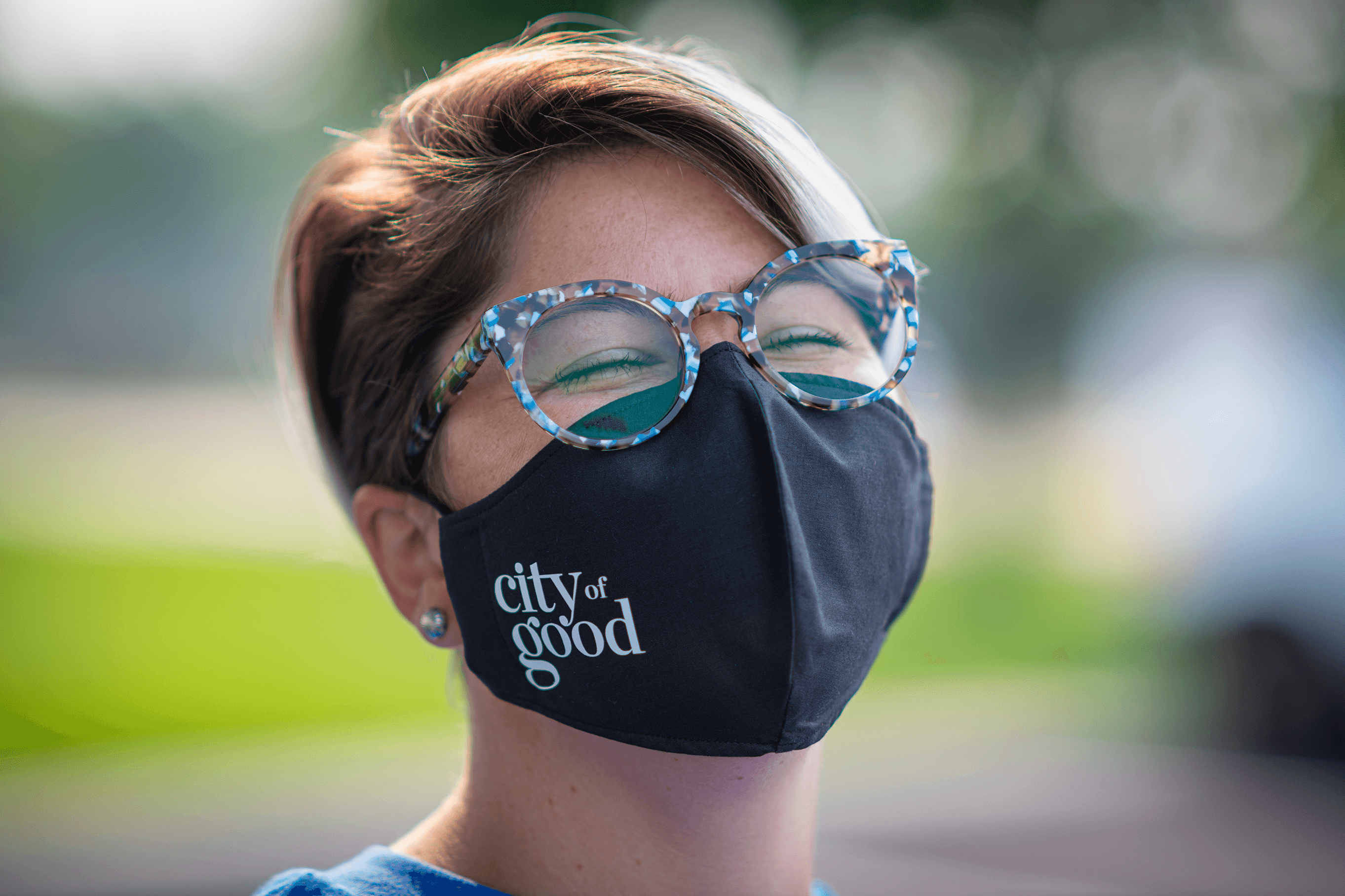 Woman in City of Good Mask Smiling